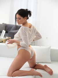 Annie Wolf Posing On A Couch 12