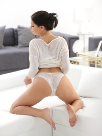 Annie Wolf Posing On A Couch 13