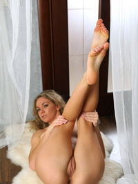 Ginny Raises Her Leg To Reveal Her Twat 09