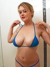 Big Boobed Babe In Tiny Bikini 10