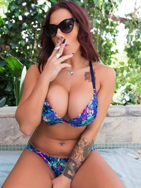 Busty Lylith LaVey Smoking On The Terrace 01