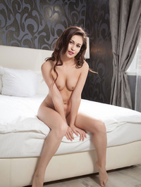 Lilian Poses Nude On A Bed 05
