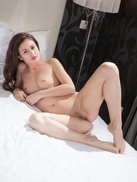 Lilian Poses Nude On A Bed 09