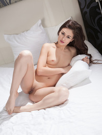 Lilian Poses Nude On A Bed 14