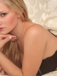 Lizzie Teases In Brown Lace 01