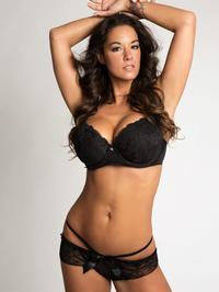 Attractive Busty Brunette In Black Lingerie 00