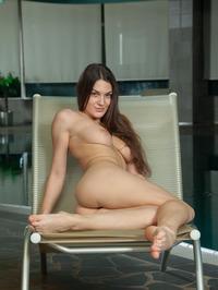 Vanda Strips Off Her Sexy Black Bikini 13