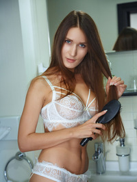 Gorgeous Brunette Elina Strips Off Her Sexy Lingerie 00