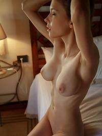 Busty Teen Mila Azul Undressing On A Bed 07