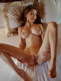 Busty Teen Mila Azul Undressing On A Bed 15