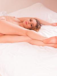 Blonde beauty Katie A stands just inside her bedroom 13