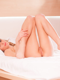 Blonde beauty Katie A stands just inside her bedroom 15