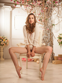 Silky skinned Ginger Frost is sitting serenely in her cream dress 01