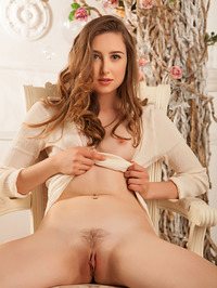 Silky skinned Ginger Frost is sitting serenely in her cream dress 02