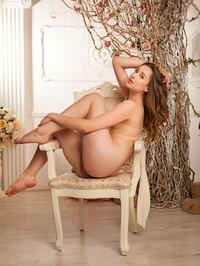 Silky skinned Ginger Frost is sitting serenely in her cream dress 08