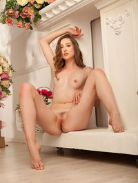 Silky skinned Ginger Frost is sitting serenely in her cream dress 17