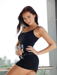If Michaela Isizzu's dress were any shorter, she'd be in danger of public indecency 01