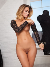 Cara Mell is trying on clothes 18