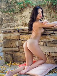Sexy brunette Sultana loves getting naked outdoors 10