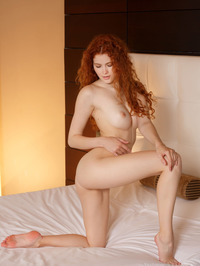 Gorgeous redhead Adel C is on her bed 12