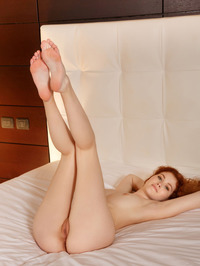 Gorgeous redhead Adel C is on her bed 17