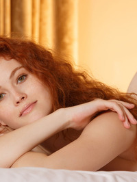 Gorgeous redhead Adel C is on her bed 20