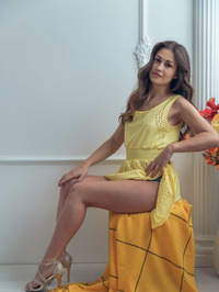 Gorgeous Lilian Slips Out Of Her Sexy Yellow Summer Dress 00