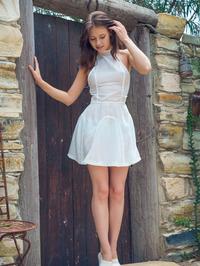 Brunette Beauty Hilary Undressing In The Garden 00