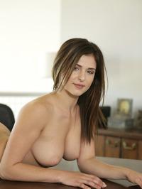 Leah Gotti Poses On A Table 08