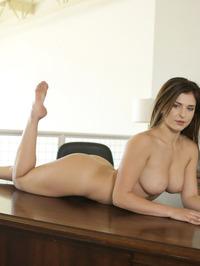 Leah Gotti Poses On A Table 09