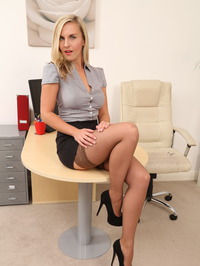 Busty Secretary Chikita Strips In The Office 00