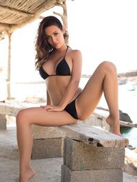 Busty Adrienn Levai In Skimpy Bikini 00