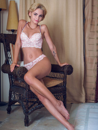 Lilit A looks exceptionally inviting as she sits in a wicker armchair 01