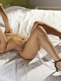 Hot Ebony Girl Kira Noirteasing On A Bed 12