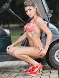 Busty Babe Shows Off Her Body In a Golf Cart 03