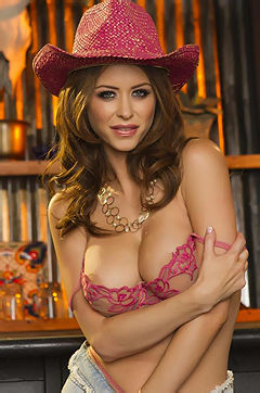 Brunette babe Emily Addison strips down her lingerie to show off her big tits.