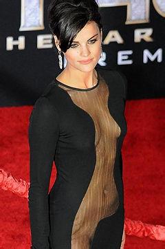 A charming celeb babe posing in a kinky black dress.
