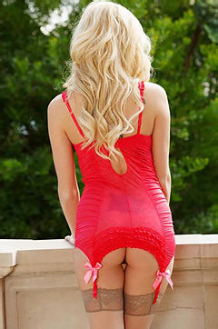 Glamour blonde Hayden Hawkens is stripping down her lingerie and stockings outdoors.