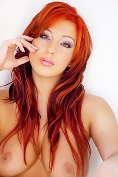 Busty Redhead Ashley Strips