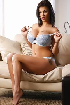 Sexy Brunette Stripping Down