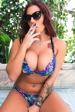 Busty Lylith LaVey Smoking On The Terrace