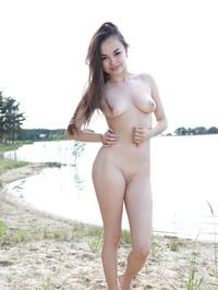 Li Moon Strips Off Her Sexy Bikini 07