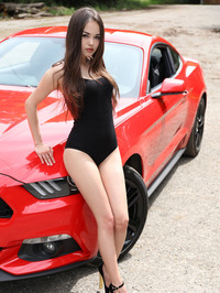 Cute Brunette Li Moon Posing Naked By A Mustang 00